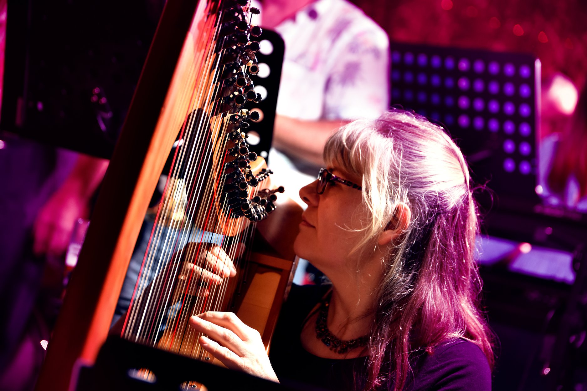 Dr Frances Thiele playing harp